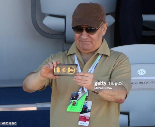 Russian billionaire and businessman Arkady Rotenberg takes a photo during the 2017 Formula 1 Russian Grand Prix race in Sochi Russia April 2017