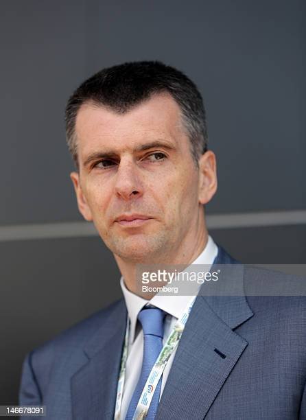 Russian billionaire Mikhail Prokhorov stops to talk to forum attendees as he walks between conference venues on day two of the Saint Petersburg...