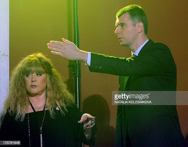 Russian billionaire the leader of proreform Pravoye Delo party Mikhail Prokhorov and pop singer Alla Pugacheva take part at a congress of his party...