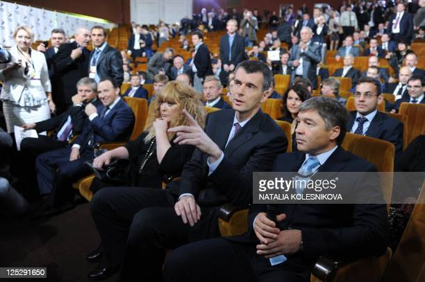 Russian billionaire the leader of proreform Pravoye Delo party Mikhail Prokhorov and pop singer Alla Pugacheva take part at a congress of Prokhorov's...