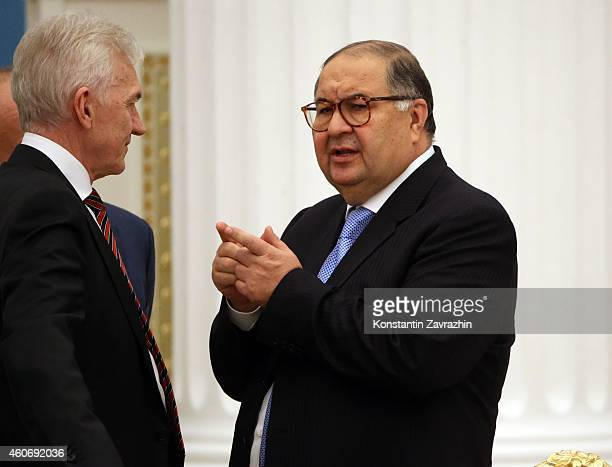 Russian billionaires and businessmen Gennady Timchenko and Alisher Usmanov attend a meeting with Russian President Vladimir Putin in the Kremlin on...