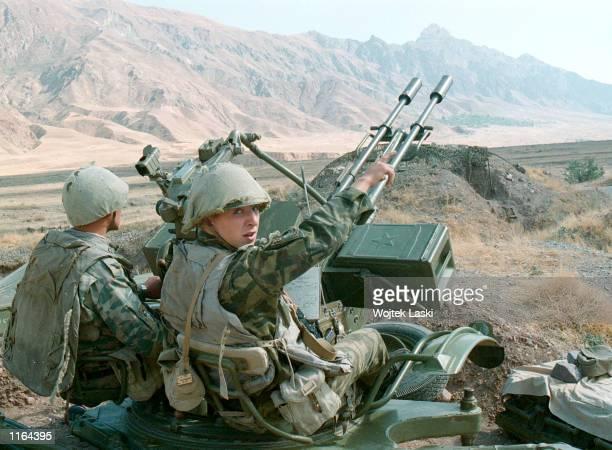 Russian border guards man an antiaircraft gun along the TajikistanAfghan border September 24 2001 in Tajikistan