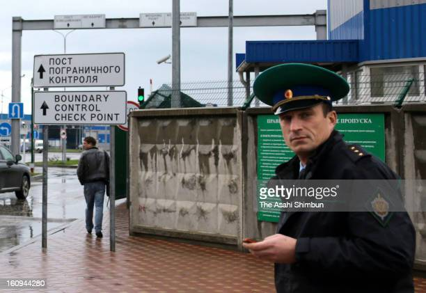 A Russian border security officer is seen at a check point between Russia and Abkhazia only four kilometers from the Olympic Park on February 7 2013...