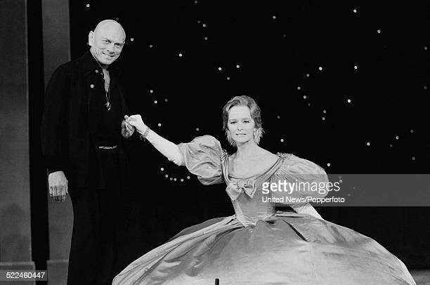 Russian born actor Yul Brynner pictured with English actress Virginia McKenna at a press call to promote the musical The King and I at the Palladium...