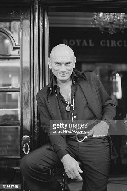 Russian born actor Yul Brynner posed at the entrance to a theatre in the West End of London on 11th September 1978