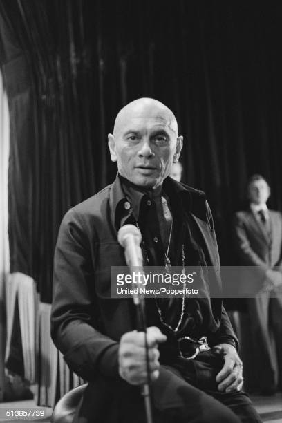 Russian born actor Yul Brynner posed inside a theatre in the West End of London on 11th September 1978