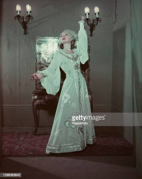 Russian born actress and playwright Elena Miramova posed on stage during a production of her comedy play 'Dark Eyes' at the Strand Theatre in London...