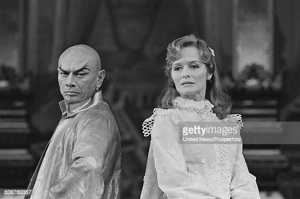 Russian born American actor Yul Brynner pictured together with actress Virginia McKenna in character as King Mongkut and Anna in the West End...
