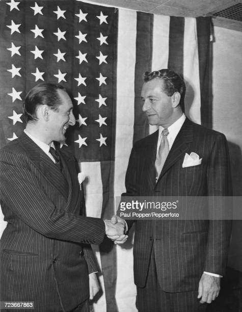 Russian born American classical pianist Vladimir Horowitz on left shakes hands with Austrian born American actor Paul Henreid as the pair receive...