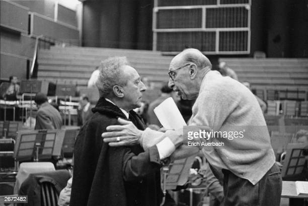 Russian born composer, conductor, pianist and writer Igor Fyodorovich Stravinsky right, embraces French poet, playwright and film director Jean...