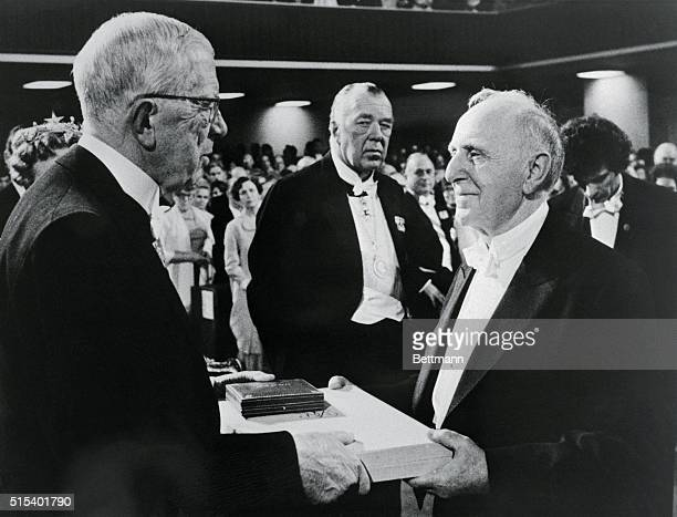Russian born Simon S. Kuznets, of Harvard University accepts his Nobel Prize in Economics from Sweden's King Gustav Adolf in a Pentecostal church...
