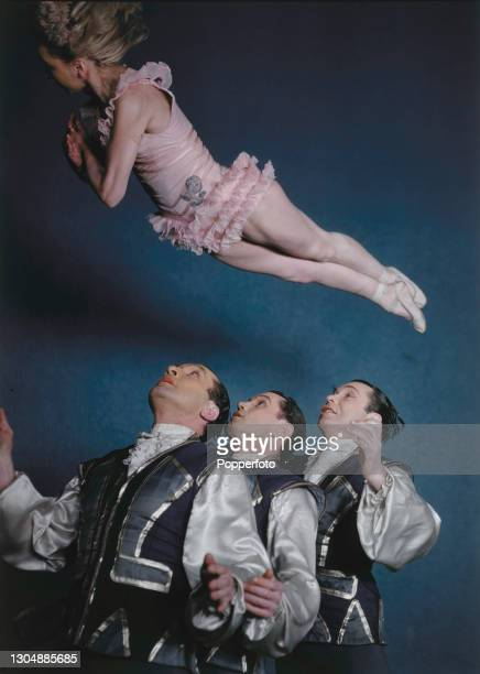 Russian born variety performers Ganjou Brothers and Juanita in action performing an adagio acrobatic cabaret act in England on 8th March 1946. The...