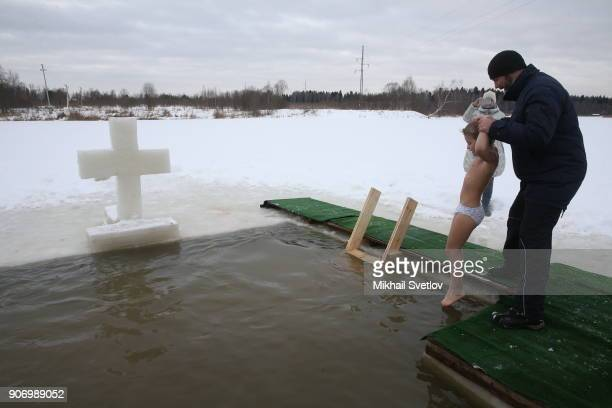 A Russian boy bathes in an icycold water of Peschanaya river as the air temerature droped to 8C on Epiphany on January 19 2018 in a villiage in Istra...