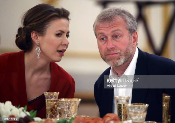 Russian businessman and billionaire Roman Abramovich listens to Polina Deripaska the wife of billionaire Oleg Deripaska during the reception at the...