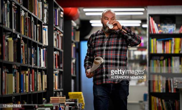 Russian businessman Boris Kupriyanov, the owner of Falanster book store, walks in his closed shop in Moscow on May 29 amid the COVID-19 outbreak,...