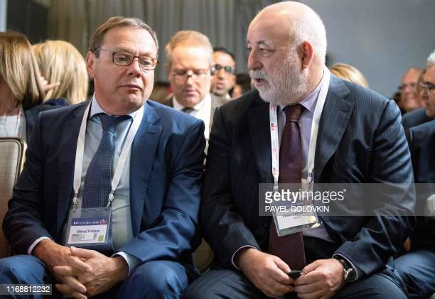 Russian businessman cofounder of AlfaGroup Mikhail Fridman and Renova CEO businessman Viktor Vekselberg talk during a conference of the Israeli Keren...
