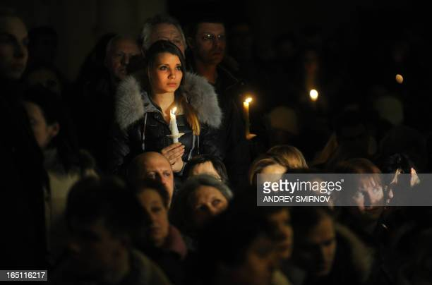 Russian Catholics hold candles during an Easter vigil on Holy Saturday at the Cathedral of Virgin Mary Immaculate Conception in Moscow on March 30,...