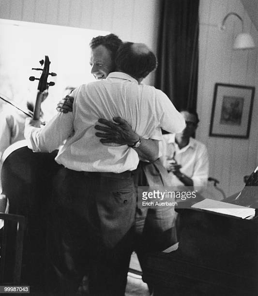 Russian cellist Mstislav Rostropovich embraces English composer Benjamin Britten in the music room of Britten's house in Aldeburgh Suffolk 1st July...