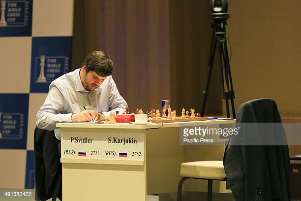 Russian Chess Grand master Peter Svidler takes note during last final round World Chess Cup 2015 in Baku
