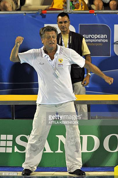 Russian coach Alexander Kleymenov gestures as he celebrates their victory on Spain on July 12 2008 in the aquatic center swimming pool of Spanish...
