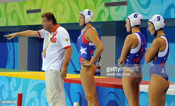 Russian coach Alexander Kleymenov shouts out plays to his team during their Women's classification 7th8th place water polo match against Greece at...