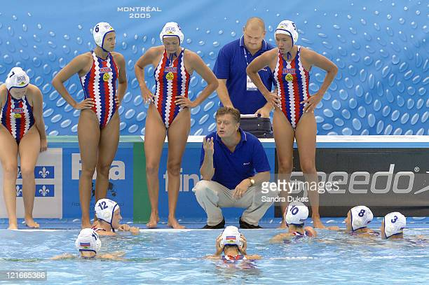 Russian Coach in Alexander Kleymenov talks to his team in a SemiFinal game won by the United States 108 the 200 meter Freestyle Final in the XI...