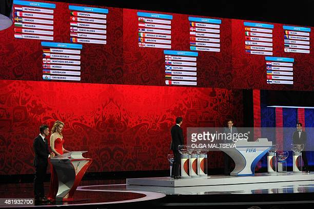 Russian cohosts Natalia Vodianova and Dmitry Shepelev stand near former German striker Oliver Bierhoff FIFA secretary general Jerome Valcke and...