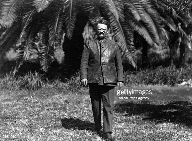 Russian Commissar of War Leon Trotsky taking a walk in the tropical garden of his villa at SukhamKale on the Black Sea in the Caucasus