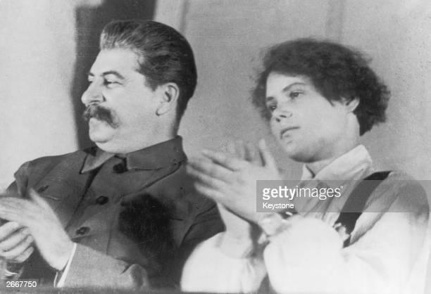 Russian communist leader Joseph Stalin accompanied by Maria Demchanko