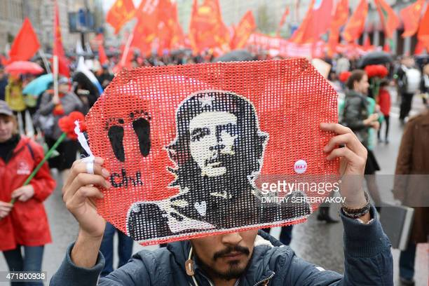 A Russian Communist Party activist holds up a portrait of Che Guevara during their traditional May Day rally on May 1 2015 in Moscow AFP PHOTO /...