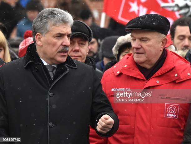 Russian Communist Party leader Gennady Zuganov speaks with presidential candidate Pavel Grudinin as they take part in a memorial ceremony to mark the...