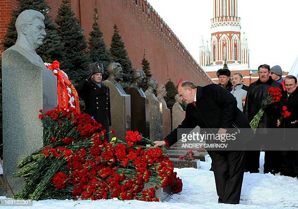 Russian Communist Party leader Gennady Zyuganov lays flowers at the tomb of Soviet dictator Josef Stalin at the Red Square in Moscow on March 5 to...