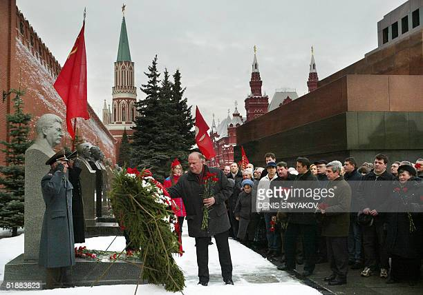 Russian Communist party leader Gennady Zyuganov with supporters pays respects at the grave of the Soviet dictator Joseph Stalin on Red Square outside...