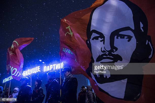Russian communist party members attend a communist rally in central StPetersburg Russia 07 November 2016 during their rally to mark the 99th...