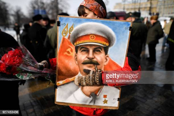 TOPSHOT Russian Communist party supporters attend a memorial ceremony to mark the 65th anniversary of Soviet leader Joseph Stalin's death on Red...