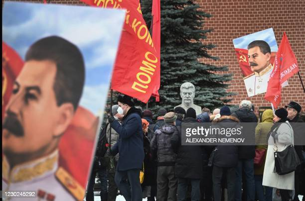 Russian Communist party supporters lay flowers to the tomb of late Soviet leader Joseph Stalin during a memorial ceremony to mark the 141st...