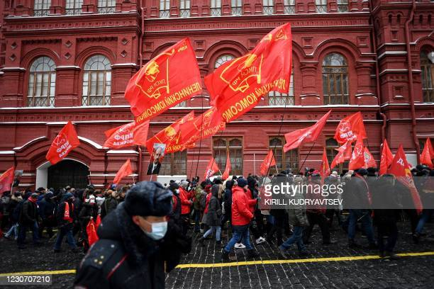 Russian Communist Party supporters walk towards the mausoleum of Russian communist revolutionary Vladimir Ilyich Ulyanov, also known as Lenin, to...