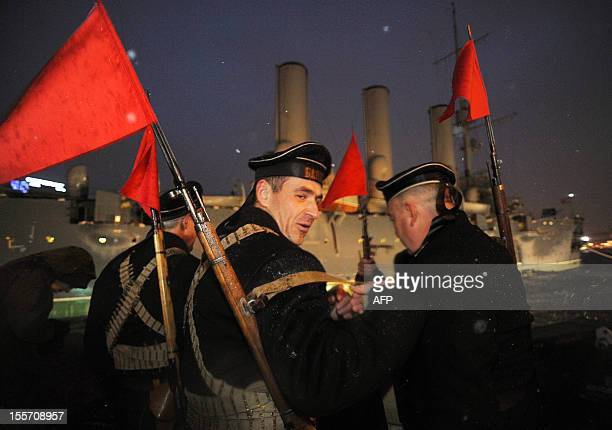 Russian Communist party supporters wearing naval uniforms of the beginning of the last century attend a rally in central St Petersburg on November 7...