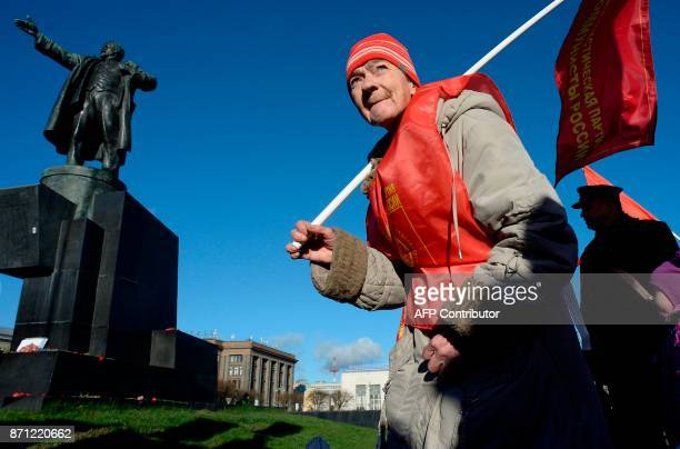 Russian Communist supporters attend a rally marking the 100th anniversary of the 1917 Bolshevik Revolution in Saint Petersburg on November 7, 2017. /...