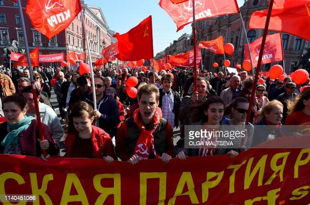 Russian Communist supporters march along Nevsky Avenue during a May Day rally in Saint Petersburg on May 1 2019