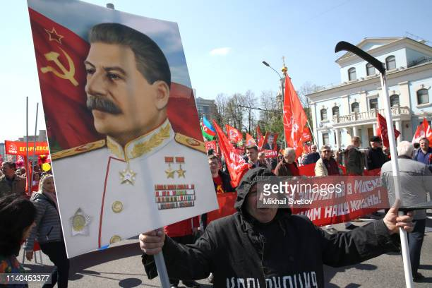 Russian communists with portrait of Joseph Stalin march during the rally marking the Labour Day in Central Moscow Russia May2019 Thousands activisits...