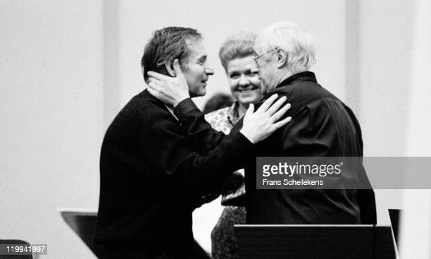 AMSTERDAM NETHERLANDS MARCH 06 Russian composer Alfred Schnittke his wife Irina and cello player Mstislav Rostropovich welcome each other in...