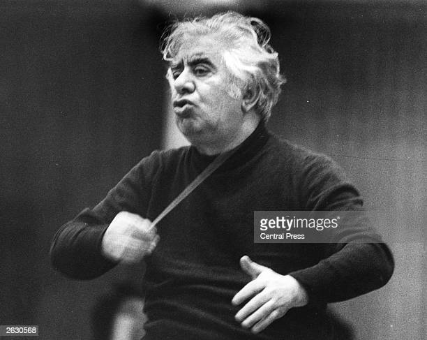 Russian composer Aram Khatchaturian rehearsing with the London Symphony orchestra in preparation for two concerts at the Albert Hall.