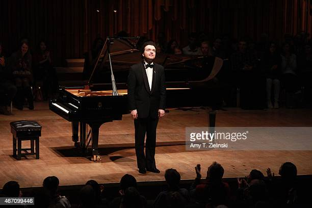 Russian concert pianist Evgeny Kissin receives applauds from the audience after performing a solo piano recital with works by composers Beethoven...
