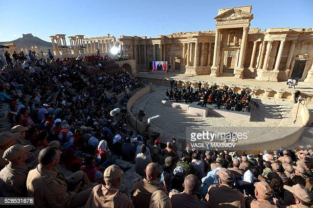 Russian conductor Valery Gergiev leads a concert in the amphitheatre of the ancient city of Palmyra on May 5, 2016. / AFP / VASILY MAXIMOV