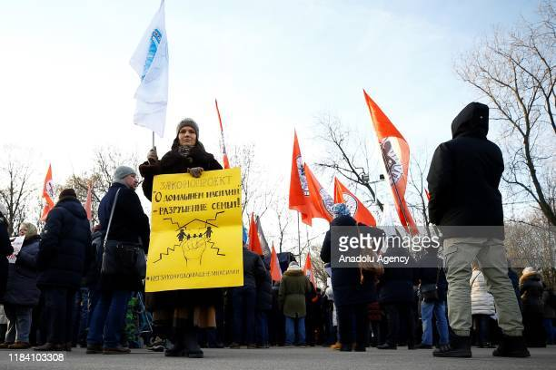 Russian conservative organizations' activists attend a demonstration against a Russian domestic violence bill in Moscow Russia on November 23 2019