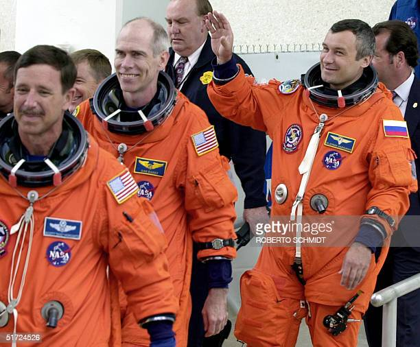 Russian cosmonaut and Space Shuttle Discovery member Vladimir Dezhurov waves to well wishers before the scheduled launch outside the Operations and...