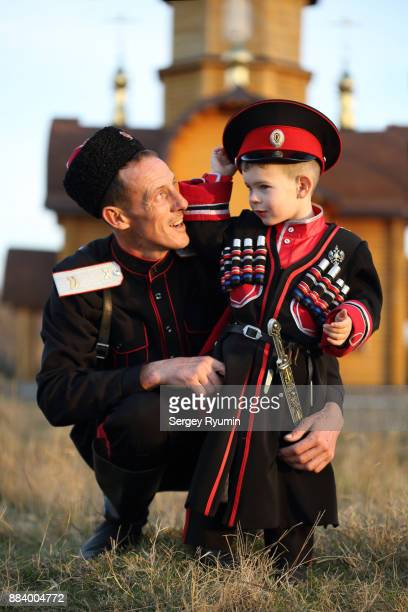 russian cossacks father and son. - eastern european descent stock pictures, royalty-free photos & images