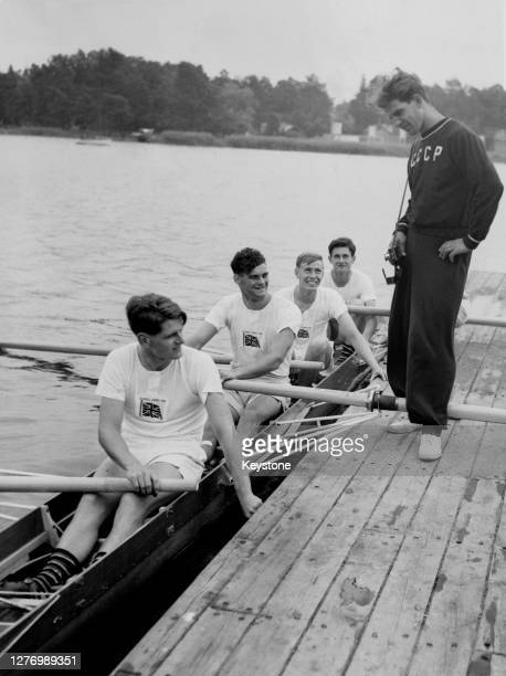 Russian coxswain representing the Soviet Union Mikhail Prudnikov on the walkway speaking to the Great Britain men's coxed four team from front...