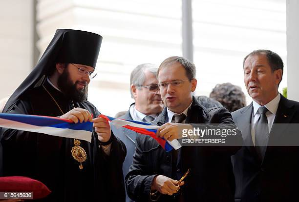 Russian Culture Minister Vladimir Medinsky cuts the ribbon next to a representative of the Russian patriarch and Bernard Mounier chairman of Bouygues...